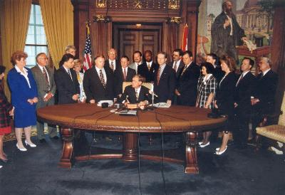 namechangelegislationsigning1995.jpg